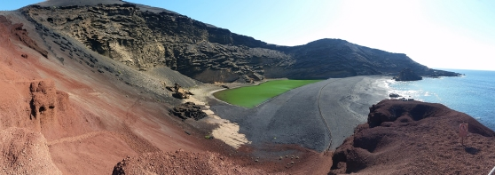 Lago Verde, Lanzarote. A green lagoon in the middle of a volcanic landscape.